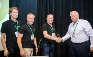 Team Yanzi (Joakim Eriksson, Niclas Sahlgren and Lars Ramfelt) accept their 2nd place trophy from IPSO Treasure Mike Justice (Grid Connect)
